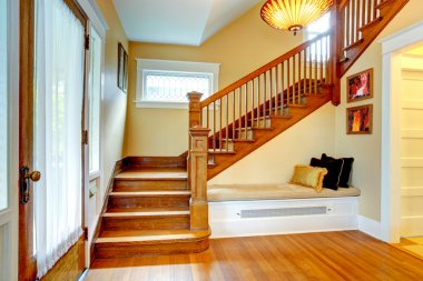 Hallway interior. Old staircase with bench