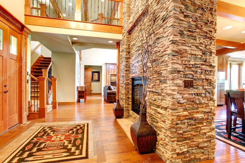 Beautiful Stone Wall With Built In Fake Fireplace. Two Vases With Dry  Branches Complete The Wall Look U2014 Foto Von Iriana88w