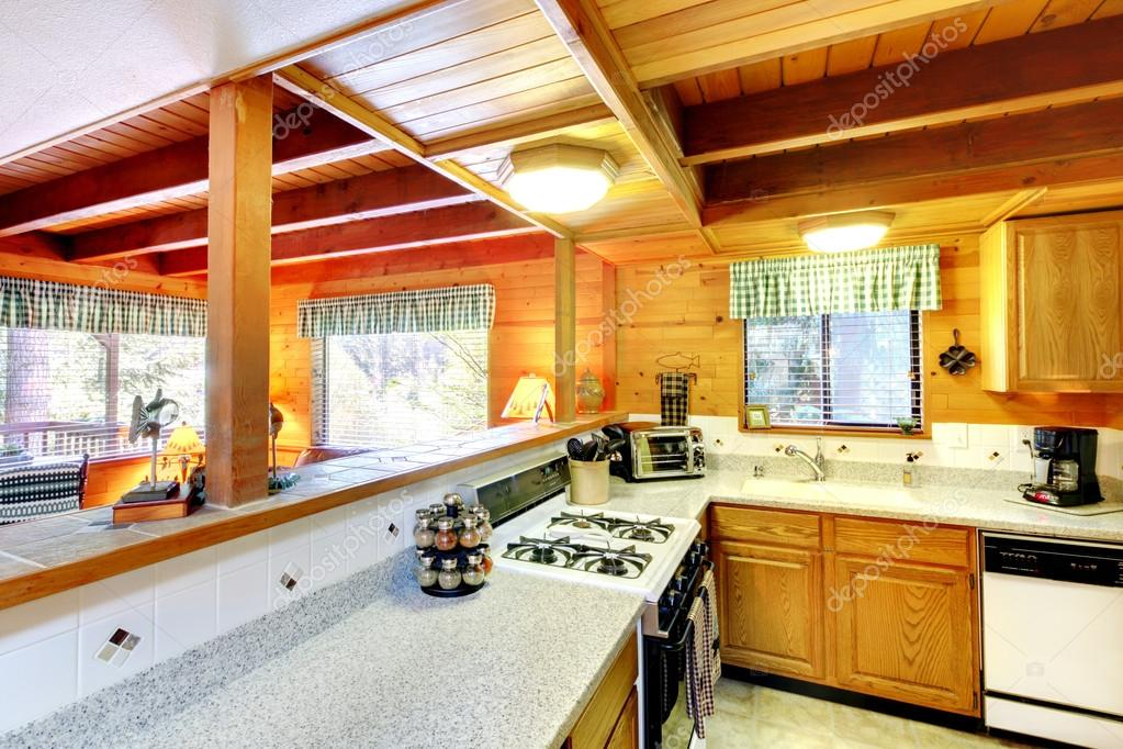 Kitchen Interior In Log Cabin House Stock Photo