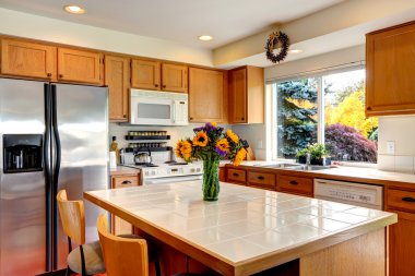 Cozy kitchen interior with island and window
