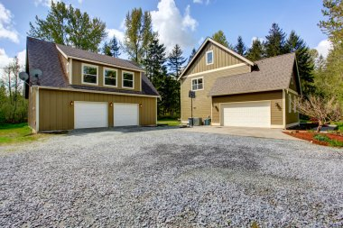 Countryside house exterior. View of entrance and gravel driveway