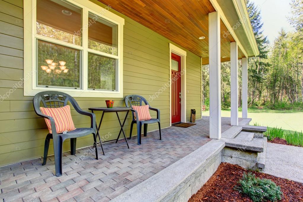 Esterno di casa di campagna vista del portico di ingresso for Piani casa di campagna con avvolgente portico