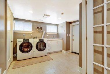 Laundry room interior in grey color