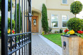 Entrance wrought iron gate to luxury house