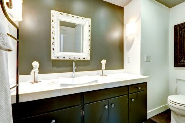 Dark bathroom vanity cabinet with white top