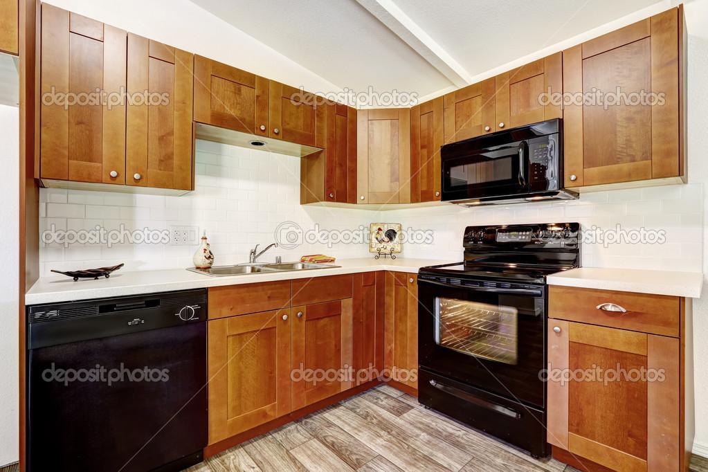 Gabinetes De Cocina Con Electrodomesticos Negros Fotos De Stock - Electrodomesticos-negros