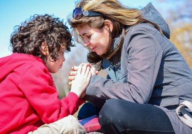 Hispanic Family Praying Outdoors