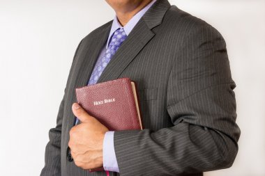 Pastor holding a Holy Bible. Pastor befora a sermon. Pastor ready to preach.Business man holding a Bible.