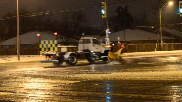Snow clearing heavy equipment in the city at night