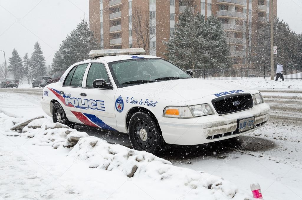 Toronto Police Car Under The Snow Stock Photo