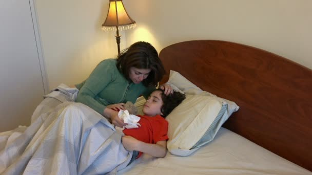 Mother looking after a sick child in bed