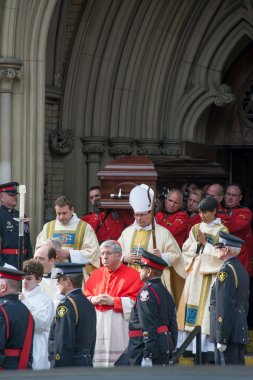 Ceremony of getting Jim Flaherty's casket back in the funeral car