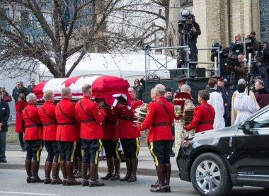 RCMP handles Jim Flaherty's casket inside the church