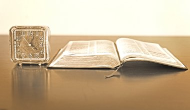 Bible and Alarm Clock on side