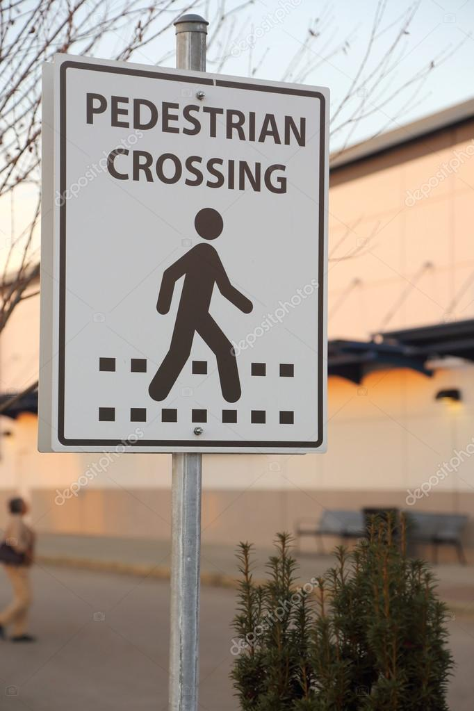 Pedestrian crossing road sign