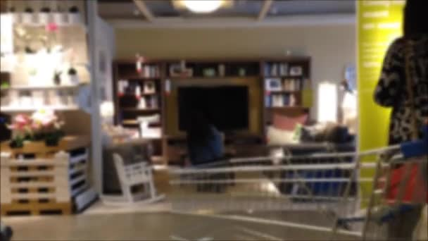 Blur motion for people shopping their furniture