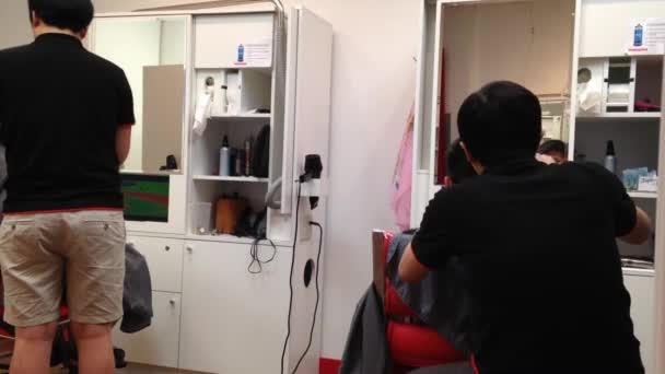 Men having an haircut in a hairdressing salon