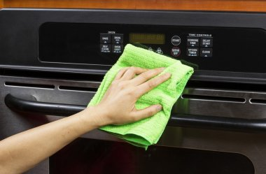 Cleaning kitchen appliance display and vents on electric oven