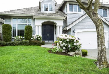 Residential home in Mid Spring Season with Blooming Flowers and