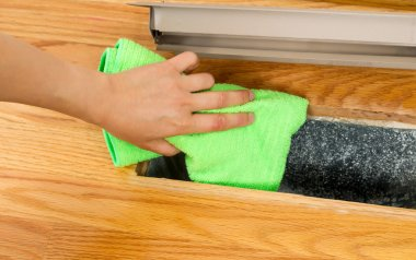 Cleaning Inside Heater Floor Vent with Microfiber Rag
