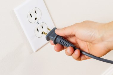Inserting Power Cord Receptacle in wall outlet