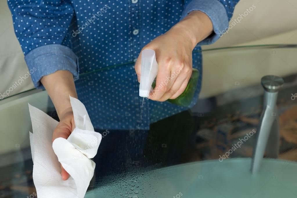 Spraying Cleaning Solutions onto Glass Table