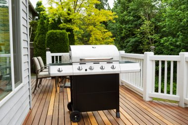Large BBQ Grill on Wooden Deck