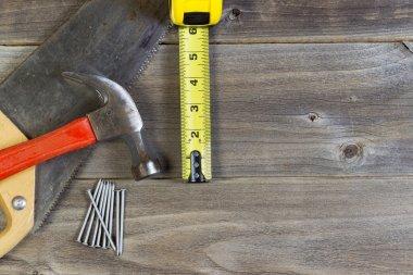 Basic home repair tools on weathered wood