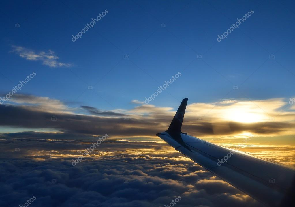 Sunrise over airplane wing