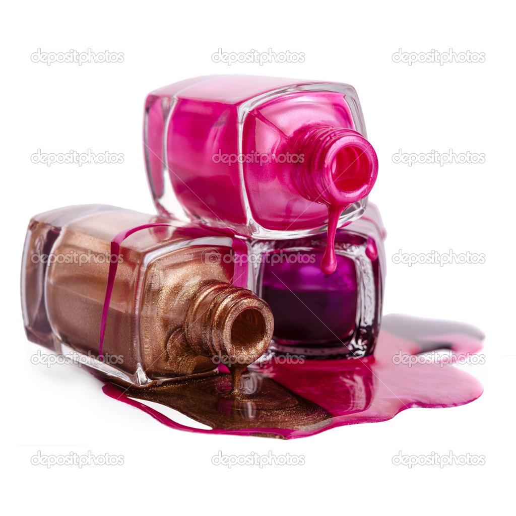 Spilled Nail Polish: Bottles With Spilled Nail Polish Over White Background