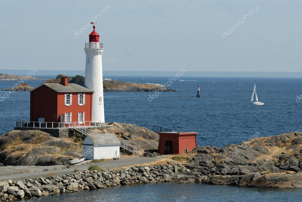 Beautiful lighthouse on the rocks in the ocean