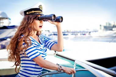 Attractive girl on a yacht at summer day