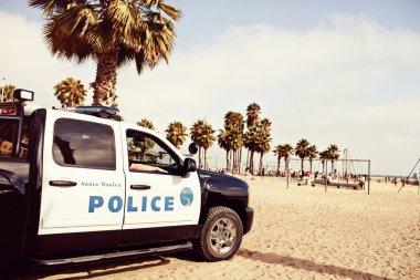 Police car on the beach