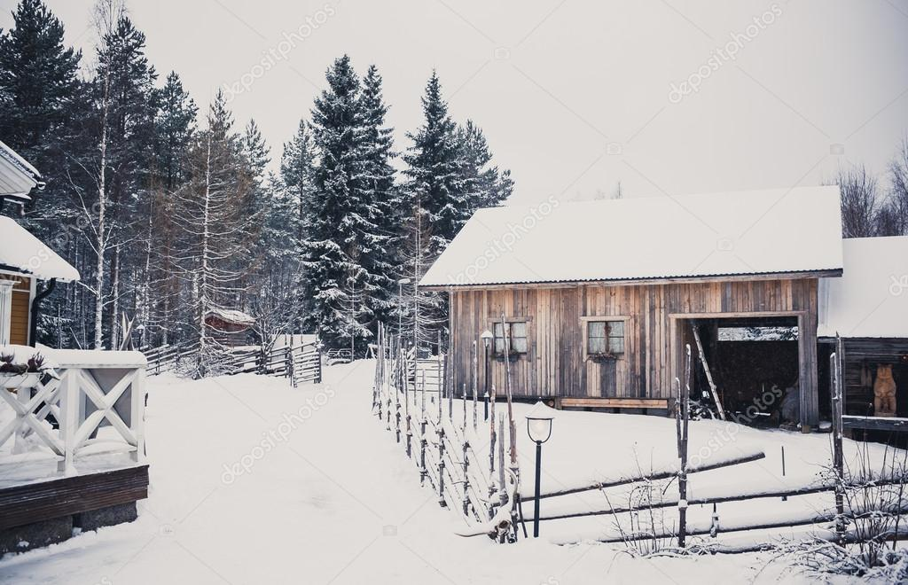 Village in winter forest in Central Finland