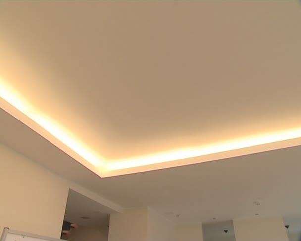 Light is switched on newly built apartment. lighting solutions.