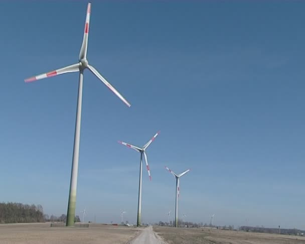 Windmills rotating in wind producing renewable electricity.