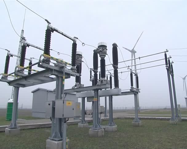 Windmill near power transformer. green power supplies to network