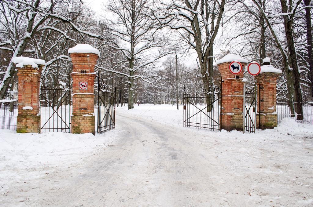 Ancient gates park dog car forbid signs winter