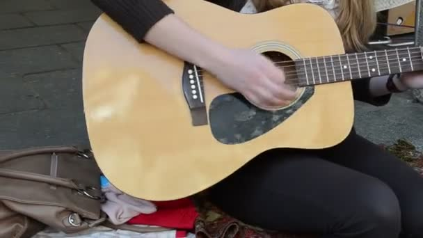 Girl play guitar sing