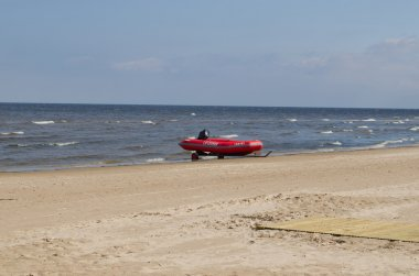 Rubber lifeguard boat trailer sea ocean shore
