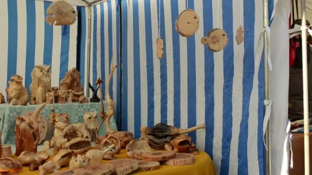 wooden hand made decorations sold outdoor street market fair