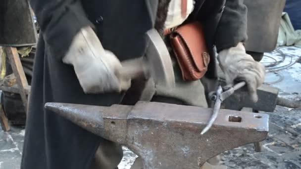 Blacksmith man hammer forge hot iron piece anvil spring festival