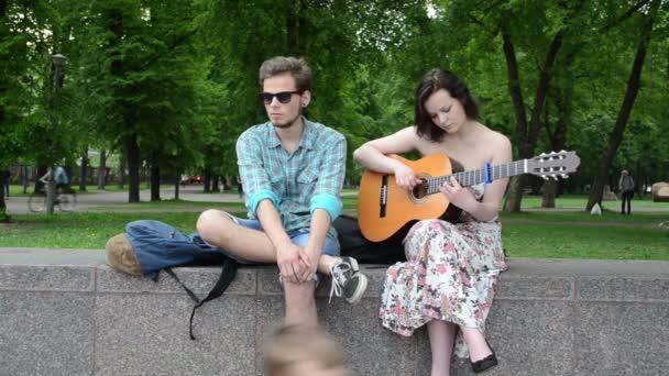 Brunette girl play sing