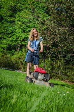 woman and fuel grass cutting machine garden