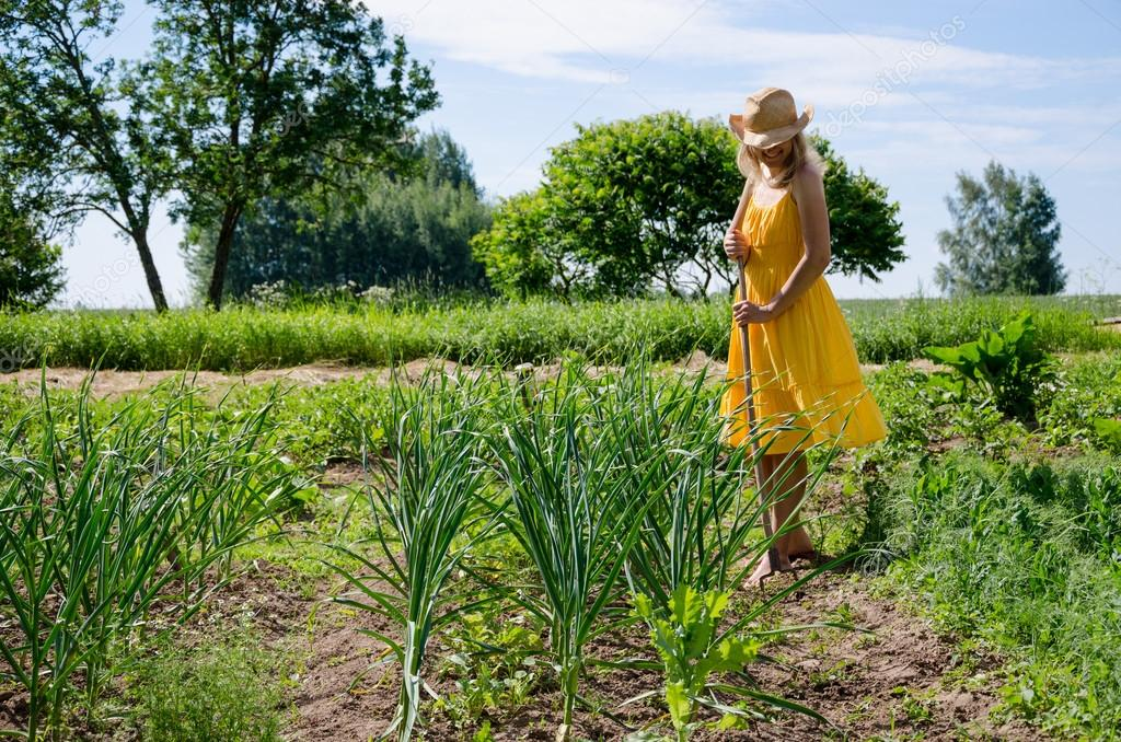 Barefoot gardener woman work in garden
