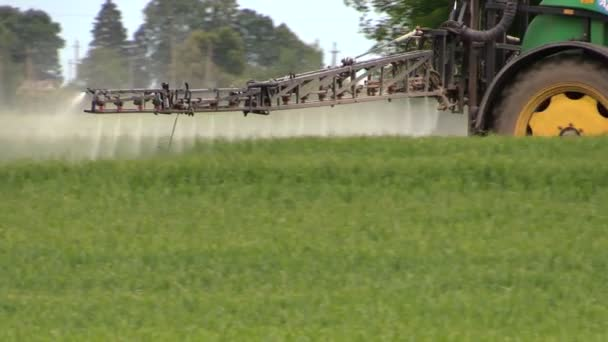 Spraying crops field with tractor and sprayer, farming, harvest