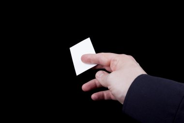 Blank business card in hand.