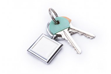 A bunch of keys with a key ring, isolated on a white background