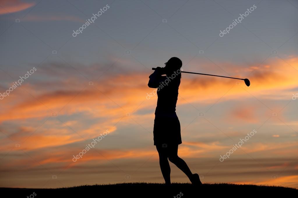Golfer at sunset.