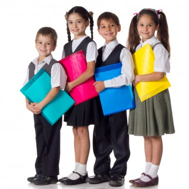 Smiling kids standing with folders
